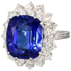 Tiffany & Co. 12.5 carat Tanzanite ring, surrounded by round brilliant cut diamonds of approx 4.5 carats, over a platinum setting.