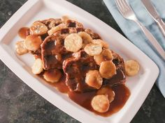 Get this all-star, easy-to-follow Banana Bread Waffles with Bananas Foster Sauce recipe from Bobby Flay