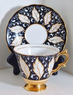 Vintage Kent Bone China Tea Cup and Saucer Taylor & Kent England Footed Teacup Leaf Pattern Crown Stamp Black and Gold by OffbeatAvenue on Etsy