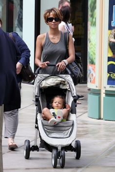 Halle Berry pushes a City Mini stroller by Baby Jogger