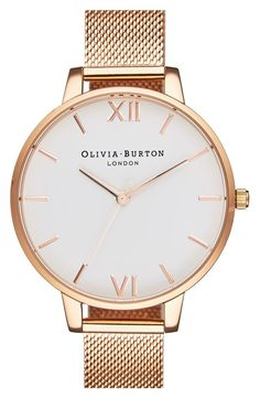 Polished stick and numeral indexes mark the minimalist dial of this menswear-inspired round watch feminized by a thin bezel, a slim mesh strap and rose gold details. / @nordstrom #nordstrom