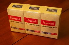 a brick of three rolls of Type still sealed in the factory cellophane. Type 4, Wok, Brick, Rolls, Traditional, Film, Movie, Film Stock, Buns