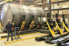Thin-Walled Tank Manufacturer Automates: Doubles Output With Fit-Up Bed Manipulator Robotic Welding Cell