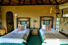Internal view of the chalet at Matobo Hills Lodge. Twin rooms have twin beds and are spacious and newly renovated with en-suite bathroom.