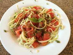 Zucchini 'pasta', tomatoes, garlic, fresh basil and balsamic vinegar.  No oil, plant strong