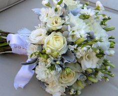 Gray and white berry and dusty miller wedding bouquet. This is a color combination made in heaven :)