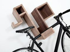 Once we had a tiny apartment in Virginia with Joe's bike hanging in our kitchen. I would have LOVED this! Way more svelte than our metal bike hooks.