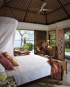 This exquisite hotel suite is at the Four Seasons Resort Bali at Jimbaran Bay. What a dream!