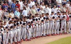 Sunday 23 June, 2002 -- Cardinals players stand in front of their dugout during a moment of silence for teammate Darryl Kile before a game between the St. Louis Cardinals and the Chicago Cubs at Wrigley Field in Chicago, Ill. Cardinals relief pitcher Dave Veres (6th from right) wipes his face.