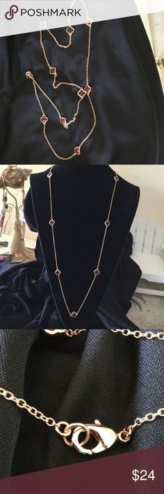 """ParkLane jewelry close outs Luck of the shamrock in simulated red crystals. Beautiful rose gold necklace with 9 clover design stones. Connected with a delicate fine chain, Extra large lobster claw clasp. Necklace is 29"""" long. Park Lane Jewelry Necklaces"""