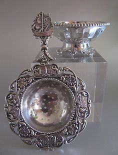 DUTCH SILVER TEA STRAINER WITH DRIP CUP