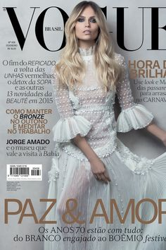 Top model Natasha Poly lands the February 2015 cover from Vogue Brazil, looking ethereal in two white looks from Valentino's New York collection. Jacques Dequeker photographed Natasha with styling by Giovanni Frasson for the new issue. The face of Emilio Pucci wears a nude lip curl and messy curls for beauty.