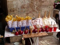 Street food in Ecuador: Chifles or banana chips, espumillas, jello cups, and candied apples