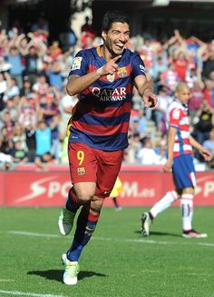 Luis Suarez of Barcelona celebrates his team's third and hat trick goal during the La Liga match between Granada and Barcelona at Estadio Nuevo Los Carmenes on May 14, 2016 in Granada, Spain.