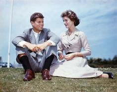 Kennedy and Jacqueline Bouvier enjoy the sunshine at Kennedy's family home at Hyannis Port, Massachusetts, a few months before their wedding in 1953.