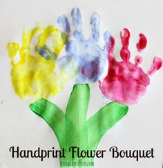 This flower themed craft idea is so simple even a dad and child could pull it off. :) If you want paint flowers with your two year old just stamp their hands in different colors for petals and then brush on a green or brown stem. You could even do a few different flowers like this for a larger painting craft.