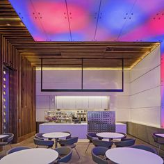 neon color in contrast to concrete and walnut paneling.