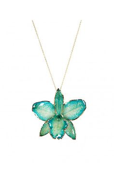 "Orchid Necklace in Turquoise: This striking necklace is made using a real orchid encapsulated in resin to preserve its delicate beauty & finished off with gold edging and suspended from an 18"" chain -"