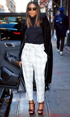 Gabrielle Union in a navy turtleneck, long coat, plaid paperbag-waist pants and heels - click ahead for more celebrity street style