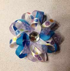 Purple and teal flower style bow.