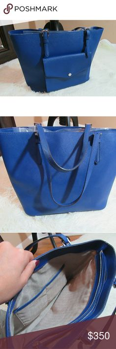 """Jet Set Travel Medium Saffiano Tote, Electric Blue Michale Kors Jet Set Travel tote in color Sapphire Blue w/ silver hardware.   MICHAEL Michael Kors saffiano leather tote bag. Thin buckled shoulder straps. Logo charm hangs from top. Inside; logo jacquard lining. Center zip compartment. Front snap pocket. 11""""H x 19"""" W x 6""""D. Jet Set Travel is imported Michael Kors Bags Totes"""