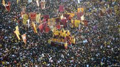 A sea of devotees clamber over one another to touch the Black Nazarene statue in the Philippine capital, Manila. Many believe the life-sized statue of Jesus Christ holds mystical powers that can wash away sins or cure illnesses.