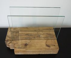 Price Doesnt Include SHIPPING.  please contact us with your location and we will provide you with a shipping quote.  The unique property of the reclaimed wood will ensure that no two pieces will ever look the same. This one of a kind magazine rack also can be great placemats holder or booking book stand. Wood base is very stable. Glass partitions will secure open book on needed page, its transparency allowing easy reading. It will be great addition to living room or kitchen. It enhance any…