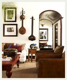 Sitars hanging on the wall. Great idea.