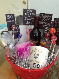 50th birthday gift basket with personalized wine glass and mug. Items from Dollar tree except for the wine ;)
