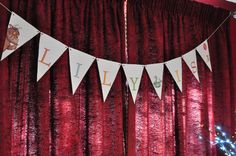 some paper bunting hanging over the food table