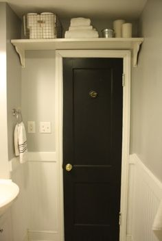 Over the door storage such a great use of wasted space! Great idea for boys bathroom.