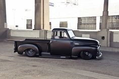 slammed matte black GMC 3100 5-window pickup