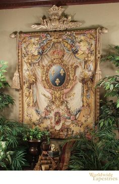 Grandes Armoiries Beige tapestry shows a French coat of arms design filled with flowers, shields, fleur de lis, and more...