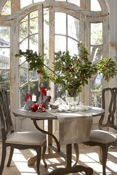 LOVE the curved french doors -- beautiful breakfast room