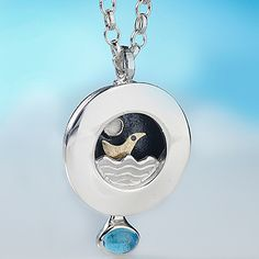 Moondance Pendant from http://www.alanardiff.com Price: €250 Description : This gold bird sways back and forth on the crest of the waves! Size: 2.3cm diameter Materials: Sterling silver, 18kt bird and gem stones.