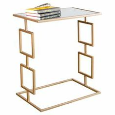 """Pairing a geometric iron base and glass top, this gold-finished side table brings elegant style to any room. Use it to display a chic lamp in the parlor or family photos and decor in the den.  Product: Side tableConstruction Material: Iron and glassColor: GoldFeatures: Geometric baseDimensions: 28"""" H x 24"""" W x 16"""" D"""