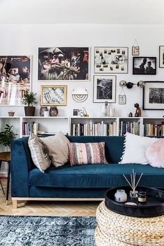 Cozy living room with blue sofa, blue rug and books