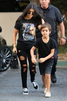 Covered up! That same day the ex of Scott Disick was also seen with son Mason in Beverly Hills