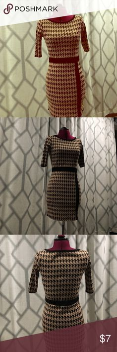 Perfect for fall/winter HOUNDSTOOTH dress Fun and perfect for the fall/winter seasons! This houndstooth dress has 3/4 sleeves and is camel colored with black. Shows a minimal amount of wear. 83% polyester 16% rayon and 1% spandex Forever 21 Dresses Long Sleeve