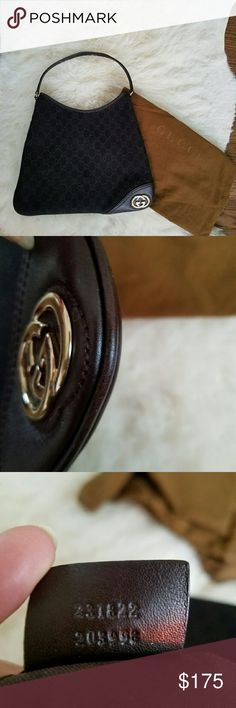 """GUCCI Monogram Britt medium hobo Authentic Gucci bag  in excellent condition.  Only minor sign of wear on leather trimming corner.  Bag is clean inside and outside.  Come with original dust bag.  14""""L ? 11""""H  Strap 8"""" drop. Color is very dark brown. Gucci Bags Hobos"""