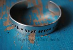 This cuff bracelet is hand stamped with 'follow your arrow', with 4 arrow stamps.  This cuff is 1/2 inch thick. I can also make it on a 1/4 inch thick cuff. Please choose the one you would like.  Please allow 1-2 weeks for delivery. Due to this being a hand stamped piece, the one you receive ...