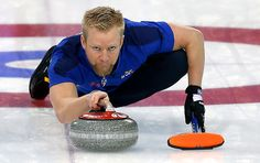 Sweden's skip Niklas Edin sweeps the ice during the men's curling match against Russia at the 2014 Winter Olympics, Sunday, Feb. 16, 2014, in Sochi, Russia. (AP Photo/Wong Maye-E)