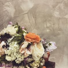 An all-natural limewash serves as a stunning backdrop to these fading flowers.