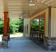 Our flush mount barn lights look right at home on this western-style Texas ranch. #barnlight #ranch #porchlighting