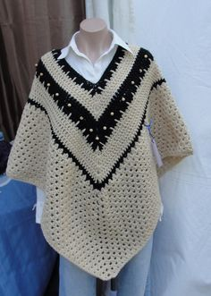 Neat look with the dark zigzag and pale beads. --Pia (Crochet poncho)