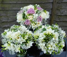 roses freesias and gypsophilia in vintage bridal bouquets and complimenting bridesmaids bouquets
