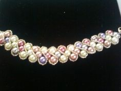 Multi colored pearl bracelet with silver seed bead embellishments