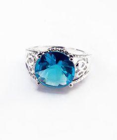 'Crystal memories'  Vintage sterling silver, aqua marine colored, blue topaz ring.