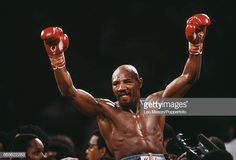 American boxer Marvelous Marvin Hagler celebrates with his arms in the air after knocking out his opponentThomas Hearns in the third round of the. Marvelous Marvin Hagler, American Boxer, Boxing History, Still Image, Champion, Arms, Superhero, Celebrities, Third