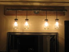 Light bar out of galvinized plumbing and Mason jars.